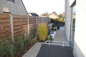 TuinOntwerpBureau De Keyser - Realisaties -Moderne tuin met waterspiegel - Maldegem